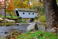 White covered bridge crossing a brook