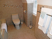 Modern tiled bathroom with wall mosaic