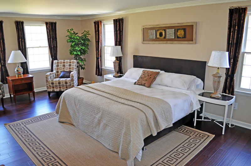 Large room with king bed and relaxing chairs